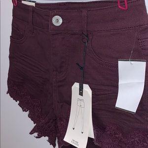 Vanilla Star purple mid rise shorts